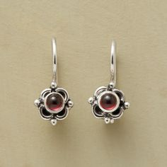 """QUATRO GARNET EARRINGS--Little garnet cabochons pop up from four-leafed settings handcrafted of sterling silver. A Sundance exclusive with locking French wires. 5/8""""L."""