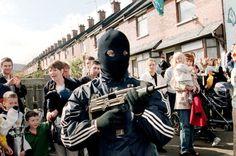 Sinister: IRA gunmen in the Ardoyne area of North Belfast in 1997