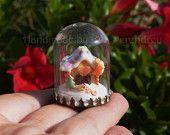 Miniature gingerbread house inside a dome, dollhouse