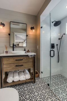 Rustic wood vanity, frameless shower and cement tile flooring (Cement Tile Shop - Bordeaux III pattern).