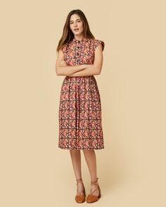 There are only a few dresses in a woman's closet that stay with her forever, and Piper is one of them. Its structured bodice, button-up front and collared neckl