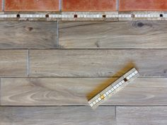 """daltile stone accent 2x12 """"copper mystery"""" transition from plank to square tile (tile setter Tina TreTina Designs)"""