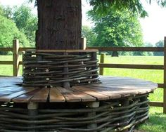 Oak & Hazel Tree Seat from Natural Fencing.  This would look lovely around our apple tree in the back garden ......