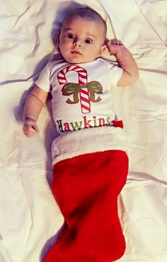 This personalized ChristmasCandy Canebodysuit &shirtby Liv & Co. is one of the sweetest baby Christmasoutfits you can find.#LivAndCo