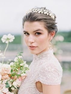 Italian Elopement in the Rolling Hills of Tuscany | Wedding editorial in Tuscany Italy, bride portrait inspiration, romantic outdoor photoshoot in Castello Di Celsa, wedding day design ideas, pearl and lace white wedding dress, blush flowers bridal bouquet with pink ribbon, crown hair accessory, beautiful earrings