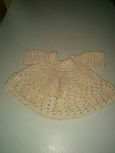 Hand made crochet dress for infants.  Contact me for orders on facebook at mylasze