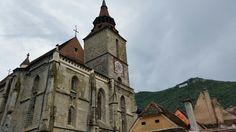 Black Church, 2 minutes walk to city center, in Brasov city - Transilvania, Romania.  Brasov name is displayed on top of Tampa mountain. #trivo