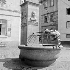 Darmstadt  Impression from Darmstadt: a little girl drinking water from the Ernst Elias Niebergall fountain, Germany 1930s.