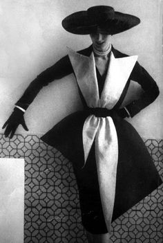 Being A Woman means being asymmetrical and unique as this tuxedo-style dress proves - Vogue 1951: