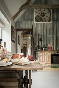 This stunning cottage is filled with vintage finds and industrial style - love the metal wall kellyelko.com