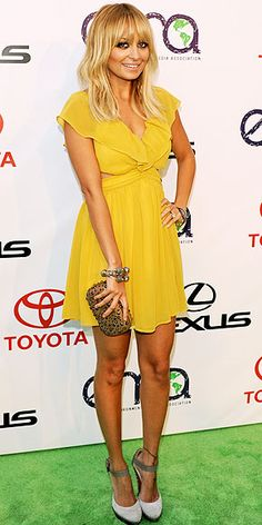 Nicole Richie in a yellow minidress
