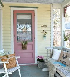 Love the colour of this door! This post is loaded with pretty summer touches - Part of a full Summer Farmhouse Tour - Town & Country Living