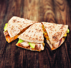 1 Flatout® Flatbread 4 oz. chicken breast, cooked and cubed 2 oz. Cheddar cheese, shredded 4 thin avocado slices Place cheese on one half of flatbread. Top with chicken breast and avocado. Fold in half. Cook in medium hot pan one minute on each side or until cheese melts. Cut.
