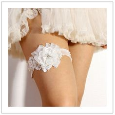 2. Accessory for the Bride: Lace Blossom Garter. Sooo pretty! #wedding