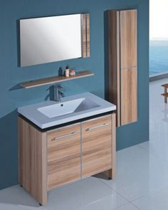 Make the most of wall space in your bathroom with this vanity, mirror and shelf set. Light maple finish means the furniture will not burden your bathroom with dark colors.  A small shelf and wall cabinet add to the already spacious storage offered by the vanity.
