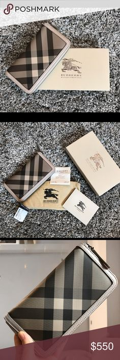 Burberry Large Smoked Check Zip Around Wallet OUT OF STOCK. Comes with receipt, tags, dust cover and box. It has soft leather trims, metallic closure on three sides, one interior zip coin pocket and eight card slots. Bits of wear around the edges of the wallet. Burberry Bags Wallets