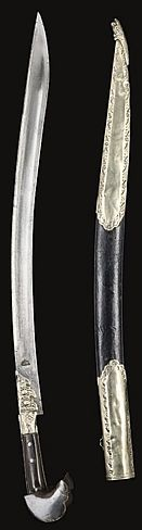Ottoman (Balkan) yatagan / yataghan, 19th c, slightly curved steel blade, stamped near hilt, the forte with silver mount and hilt of horn with silver mounts, the stitched leather scabbard with silver upper and lower, the end terminating in a dragon with open mouth - 30 3/4in (78cm).