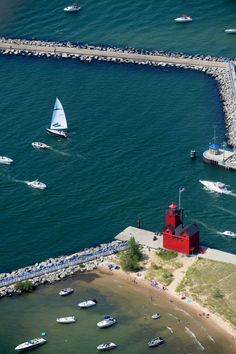 HOLLAND - an aerial view of the red lighthouse at Holland State Park on Sunday, August 16, 2015. (Emily Rose Bennett | http://MLive.com)