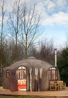 Modern Yurt. I like how the exterior is much more attractive than the regular style...(sigh)  One of these days......