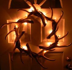 Just when 'ya think an antler wreath can't get any cooler... someone goes and adds twinkle lights ❤️ This is a MUST do!!! Blueridge Lighting   Antler Wreath