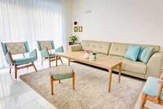 mid century home decor, living room redecorated with renovated furniture from the 60's
