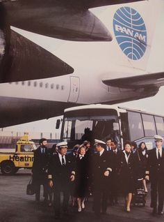 1980s A Pan Am crew arrives at their outbound aircraft at London, Heathrow airport.