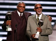 Tommie Smith and John Carlos. They have had a complicated relationship throughout the years...
