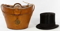 Lot 419: Beaver Top Hat in Leather Case; Silk lined beaver fur hat by Knox of New York having tan leather sweat band with original leather and silk carrying case monogrammed J.H. O'B