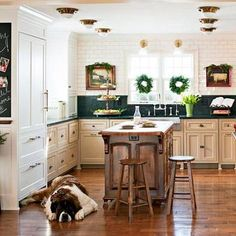 Get holiday decorating inspiration from this Minnesota home, decorated in Yuletide elegance. Pretty kitchen and cute dog..