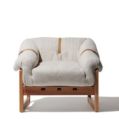 A bold accent chair with a variety of eye-catching details, the Larsen Lounge Chair oozes comfort with its seat that seems to overflow over the geometric wooden frame My Living Room, Home And Living, Living Room Decor, Living Spaces, Modern Living, Home Furniture, Furniture Design, Industrial Furniture, Modern Furniture