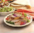 Happiness is a warm tortilla filled with sautéed onions and peppers, and chicken breast strips.  Now you can enjoy this Southwestern favorite anytime, in no time, with Grilled & Ready® products.