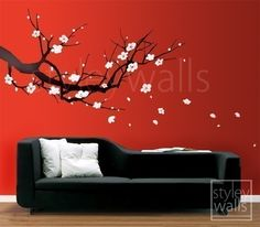 Cherry Blossom Sakura Tree (LARGE) - Vinyl Wall Decal. This LARGE Cherry Blossom Sakura Tree decal measures 60 wide by 33.2 high comes falling with flowers. You can arrange the flowers as you want. The whole visual measures 77.5 x 38.5. You can choose two colors; one for the tree, one for the flowers.
