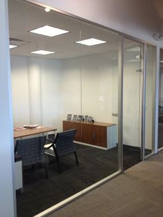 Frameless Glass demountable wall system by Dynamic Hive offers a new, clean and open feel to office design -  available at www.ofw.com