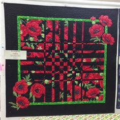 A variation of Ricky Tim's Convergence quilt design. Bold large print fabric with strong contrast black to make the converging strips. Applique and high contrast borders.