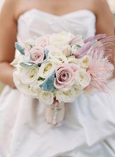 bouquet with feathers // photo by Caroline Tran // http://ruffledblog.com/elegant-san-diego-wedding
