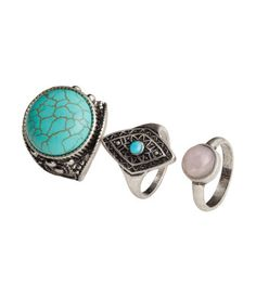 Rings in antique-finish metal with stone-like beads.