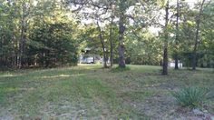 Land, Lake and Lazy Days ahead!! Enjoy this 6 acres of Hickory county mostly wooded. Well/Septic/Electric on site. Small Cabin to hunt from or camp in. Large Covered building for RV or Camper, Leave it open or close it in for a shop. The possibilities are wide open like the land here. Come take a drive by today and call Rob for your own showing!! in Urbana MO