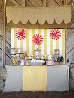 Have Fun with a Candy Bar  Encourage a kid-in-a-candy-store mentality with this self-serve favor station, which pairs penny candy in inexpensive glass jars with muslin to-go bags stamped in a custom design.