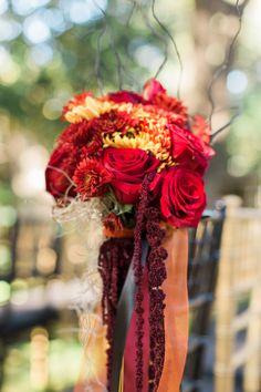 Florist - Flora Fetish. Venue - Vista On Seward Hill. Coordinator - Tracy Collins. Photographer - Sophie Epton Photography. #AustinTXweddings #weddingfloral #roses #VOSH #blackbaccararose #blackwillow #texaswedding #fallwedding  #ceremony #fallflowers #blackurn #yellowflowers #orangethistle #blackmillet #blackmagicrose #chilisrose #amaranthus #bronzefootballmums #mums #aisleflowers