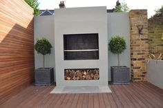 Modern Garden Design Artificial Grass Raised Beds Hardwood Decking Cedar Privacy Screen Bespoke Fireplace BBQ Balham Clapham Battersea Chelsea Fulham London Contact anewgarden for more information Fire Pit Seating Area, Outdoor Kitchen Design, Modern Garden Design, Outdoor Garden Furniture, Outdoor Living Design, Garden Design London, Modern Patio, Garden Design, Outdoor Fireplace Designs