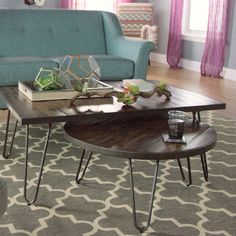 Full of mid-century modern appeal, our low-to-the-ground coffee table features metal hairpin legs and an acacia wood top distressed for a reclaimed feel. Nest it with our round coffee table in front of the sofa for a combined piece with expandable surface space, and complete the mod-inspired look with our end table.
