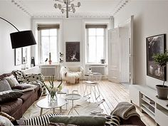 This Swedish abode made up of neutrals is a study in layered textures, materials, and architectural details.