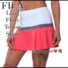 "FILA Long Flirty Tennis Skort This flowing Tennis Skort features an elastic waistband, built-in compression short, pleating at front hem, moisture-wicking stretch fabric for enhanced mobility. Fila logo at back waist. Color: White, Coral w/ Gray Strip. Skirt length: 14"" & 4"" inseam. Made of cooling jersey, 84% polyester 16% spandex Inside White Forza ball shorts made of lightweight resistance jersey, 85% polyester 15% LYCRA fiber and 35% Coolmax. Size Small. Semi-fitted I have the Matching…"