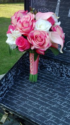 This listing is made to order and Includes: 1 10-12in Diameter Bouquet as shown in the photos. Flowers in Bouquet include Real Touch Coral Pink Roses, Real Touch Coral Pink Rose Buds, Real touch Ivory