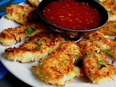 Coconut Chicken with Sweet Chili Sauce, very yummy! Instead of frying, I baked mine first and then pan seared them