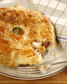 """Incredible Chicken Pot Pie! Made this with bought chicken stock and Martha's """"Classic Pot Pie"""" pie crust instead of puff pastry. AMAZING. So, so good. Will definitely be my go-to recipe for years. Next time I might make either more sauce or less filling, cause I like when there's extra to sop up with bread or potatoes!"""