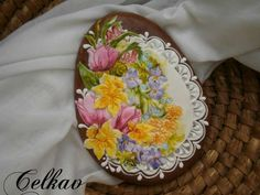 Such pretty detail - tulips, daffodils, violets, and lace gracefully placed on an egg-shaped cookie - ready for Easter.