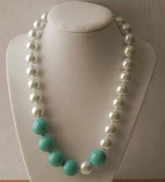 Chunky Pearl and Turquoise Necklace Statement Necklace Asymmetrical Necklace Pearl Necklace About 19-1/4 long. 18mm turquoise dyed magnasite beads, asymmetrically placed with 14mm glass pearls, and finished with smaller 8mm Swarovski crystal pearls and a sterling silver lobster