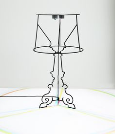 kartell goes bourgie in paris to celebrate 10 years of ferruccio laviani's table lamp