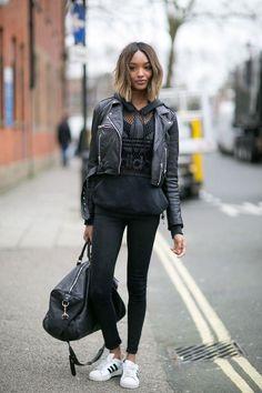 Jourdan Dunn wearing an Adidas sweatshirt, black skinny jeans, and a leather jacket   Street Style: 25 Cool Sweatshirt Outfit Ideas